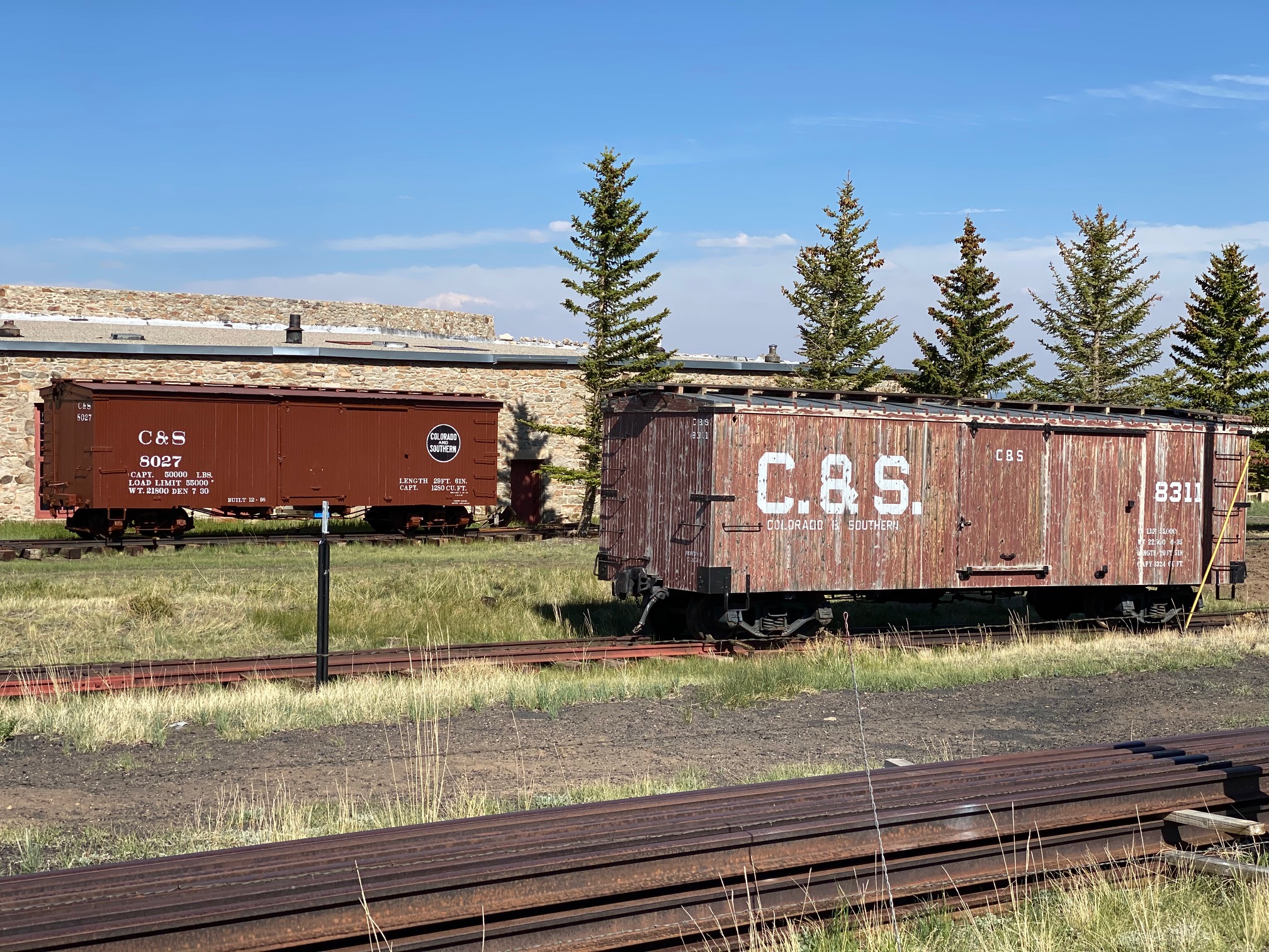Colorado and Southern Boxcars 8027 and 8311 near the Roundhouse